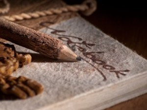11119700-wooden-pencil-on-the-old-style-notebook-closeup-for-writing-themes